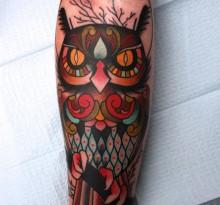 Татуировка совы на предплечье