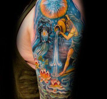 Цветная тату с Водолеем на плече