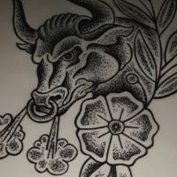 Бык с паром из ноздрей и цветком