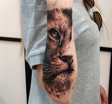 Женская тату льва на предплечье
