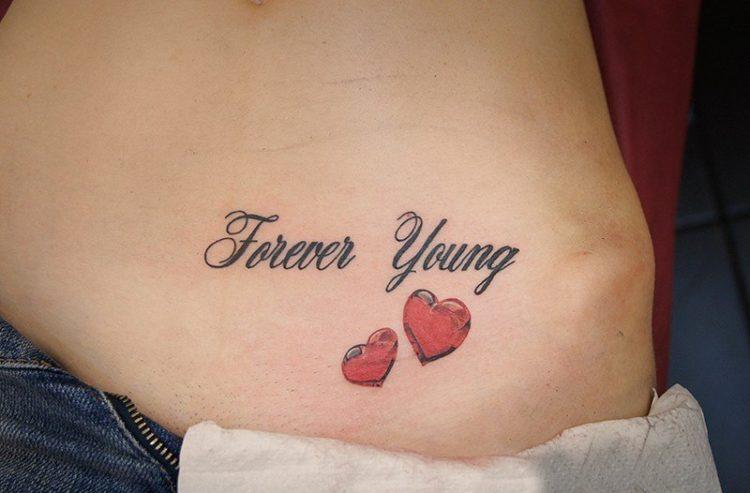 Надпись Forever Young с двумя сердечками
